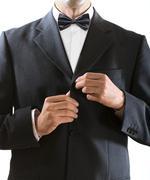 man clasps a jacket button - stock photo