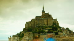 Mont Saint-Michel is a monastic building in France, time lapse Stock Footage