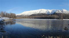 Serene Alaska River and Glorious Winter Mountains Behind Stock Footage