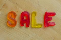 Sale in gummy letters Stock Photos