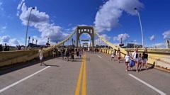 Pirates Fans Walk Across Roberto Clemente Bridge Stock Footage