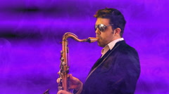 sexy cheesy saxaphone sax playing - stock footage