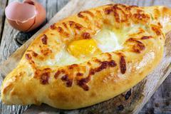 Georgian cheese pie and yolk closeup. Stock Photos