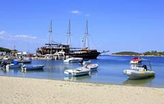 Ships in the harbor of Ormos Panagias Stock Photos
