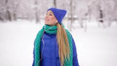 Running girl in snowy winter park Stock Footage