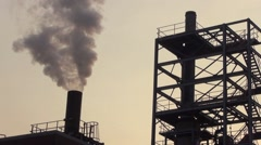 Smoke and steam discharged from  powered electrical generation facility Stock Footage