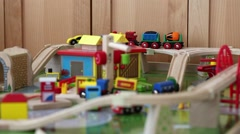 Little boy playing with a toy train and cars Stock Footage