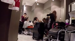 People having an haircut in a hairdressing salon Stock Footage