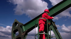 Oil Worker and Pumpjack Drilling Rig Stock Footage