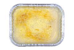 Lasagna in aluminium recipient isolated on white. Stock Photos
