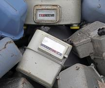 old obsolete disused gas counters in a landfill of toxic waste - stock photo