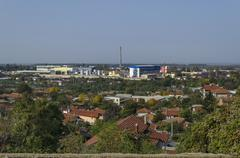 Residential district and part of industrial enterprise zone in the Ruse town Stock Photos