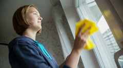 Young Women cleaning a window,  Silhouette of a woman working with a rag Stock Footage