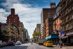 7th avenue, seen from 23rd street in manhattan, new york. - stock photo
