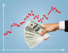 Close up of male hand holding dollar cash money Stock Photos