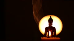 Silhouette of Buddha and incense smoke Stock Footage