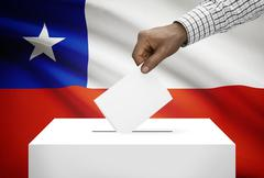 ballot box with national flag on background - chile - stock photo