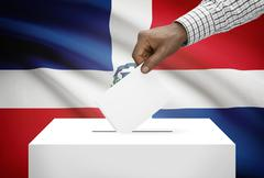 ballot box with national flag on background - dominican republic - stock photo