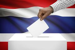 ballot box with national flag on background - thailand - stock photo