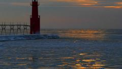 Ice Glazed Pier and Lighthouse Under Winter Dawn Sky Stock Footage