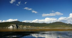 4k clouds mass rolling over mountains reflect on lake,Shangri-La yunnan,china. Stock Footage