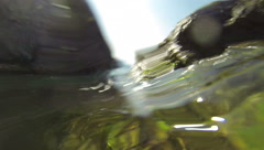 Surf the waves, the camera goes under water Stock Footage