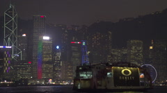 Victoria Harbour Ferry passing by Hong Kong Island And Kowloon Stock Footage