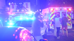 Fire truck and ambulance guys walking  with cel phones lots of flashing lights Stock Footage
