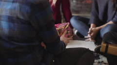 Young woman receiving gift from friends Stock Footage