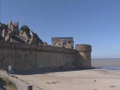 Low tide in tidal bay + pan rocky islet of Le Mont Saint-Michel Stock Footage