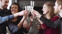 Young men and women enjoying champagne Stock Footage