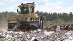 bulldozer at the city dump - stock footage
