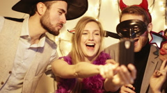 Young men and women enjoying at party Stock Footage