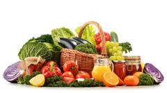 wicker basket with assorted organic vegetables and fruits  isolated on white - stock photo