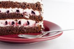 multilayer cake on plate close up - stock photo