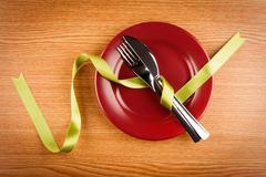 marsala plate with dishware and ribbon - stock photo