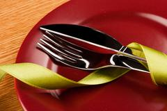 Marsala plate with dishware and ribbon Stock Photos