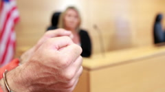 Close up of a criminal hands with handcuffs Stock Footage