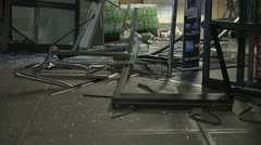 Close up of Damaged Store Front After A Vehicle Crashed through the front door - stock footage
