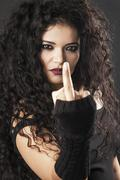 Rocker girl making middle finger gesture and looking closeup Stock Photos