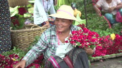 Mandalay, Flower seller on the market Stock Footage