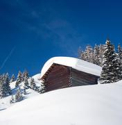 Lonely hunting snowbound lodge in alps, italy Stock Photos