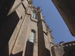 Mont Saint-Michel Abbey, Gothic front of the merveille low angle + pan Stock Footage