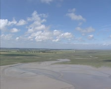 High angle view across Mont Saint-Michel bay, polders, Duchesse Anne dike + pan Stock Footage