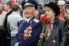 the unknown veteran on the victory day in moscow during march of communists - stock photo