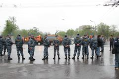 Staff of the russian police protects political procession Stock Photos