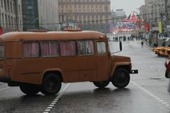 Retro the bus on streets of moscow in day of procession of communists Stock Photos