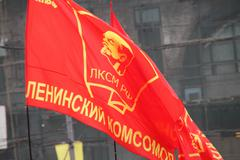 flag of komsomol during procession of communists - stock photo