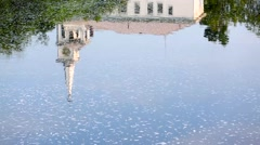 The reflection of a church steeple on moving water Stock Footage