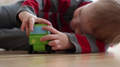 Little boy plays with toy truck Stock Footage
